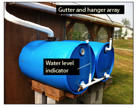 Figure 10d. Gutter and gutter-hanger array for conveying rainwater to storage tanks without using a fine-mesh filter. Also showing alternate way to connect two or more food-grade, 55-gallon barrels in a series for rainwater storage and delivery without the need for a pump.