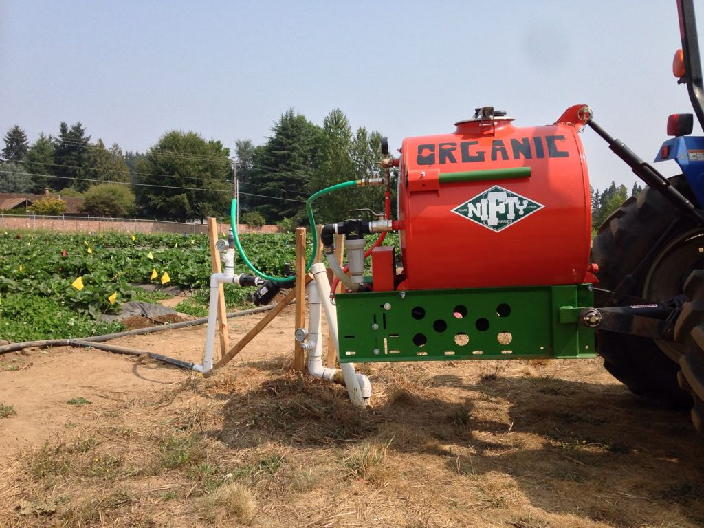 Figure 9. Fertigation of certified organic strawberries (day-neutral) using a PTO-driven pump and tank.