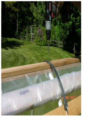 Attach the bungee cord at its center to the backbone. This will hold the rolled-up plastic for easy access to both sides of the raised-bed cloche.