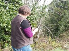 Photo: Norma Kline, © Oregon State University Figure 11. Finding an established property corner with a GPS receiver.