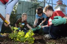 Students at a community garden on the Oregon Coast.